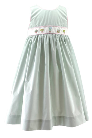 Light green sleeveless summer dress with handmade garden embroideries. A sweet and chic French style for little girls