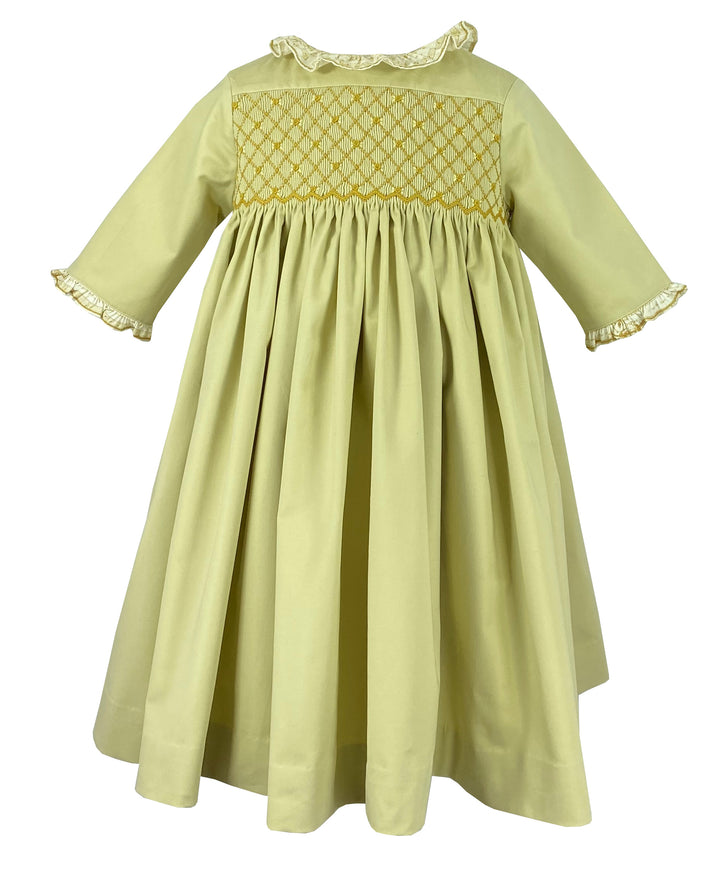 Yellow Sonata smocked dress with keynote print details. A poetic chic classic French style for little girls