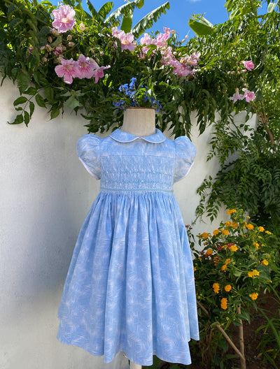 Light pastel blue palm leaf print Peter Pan collar smocked dress with delicate puffed sleeves for Spring and summer.