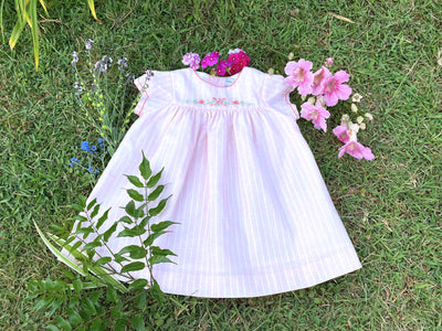 Beautifully handmade Spring Summer dress featuring delicate handmade embroideries for babies and girls.