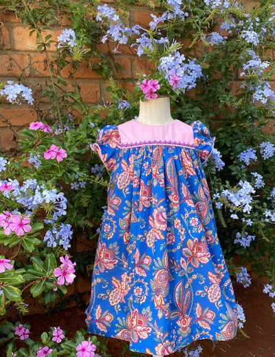 Beautifully handmade fancy floral print spring summer dress for girls by Charlotte sy Dimby