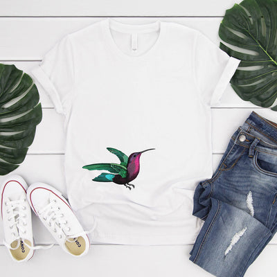 White t-shirt with colourful hummingbird image on front bottom right corner