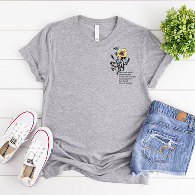 This grey t shirt has a yellow vintage  rose illustration & an inspirational quote