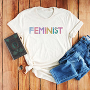 Cream slogan feminist t-shirt with colourful painted typography