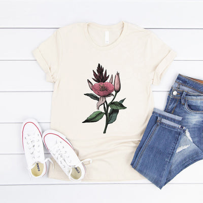 Cream t-shirt printed with a vintage botanical illustration of an evening primrose flower