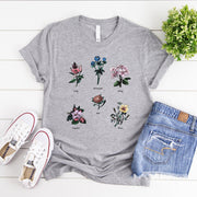 Grey floral feminist t-shirt with gender role quote