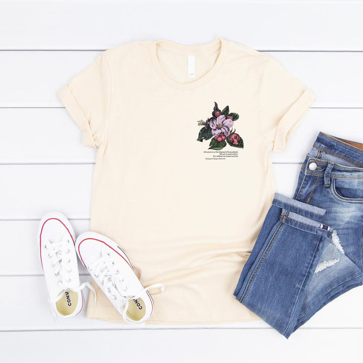 Cream t shirt with vintage crab apple flower illustration and climate change quote on the pocket