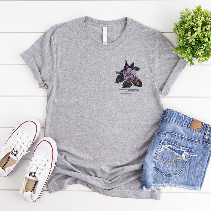 Grey t shirt with vintage crab apple flower illustration and climate change quote on the pocket