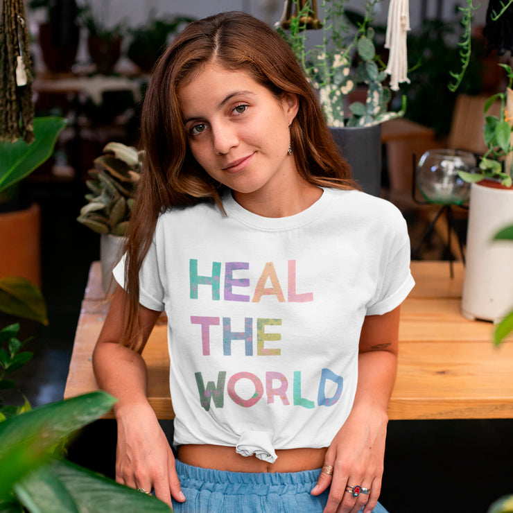 Organic tshirt with 'heal the world' written on it in colourful font