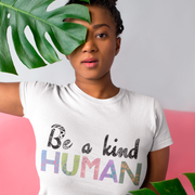 white cotton organic be kind shirt with quote 'be a kind human' in colourful typography