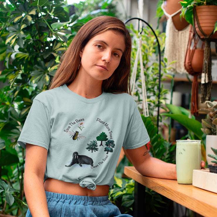 Pale blue save the bees t shirt with the quote save the bees, clean the seas, plant more trees.