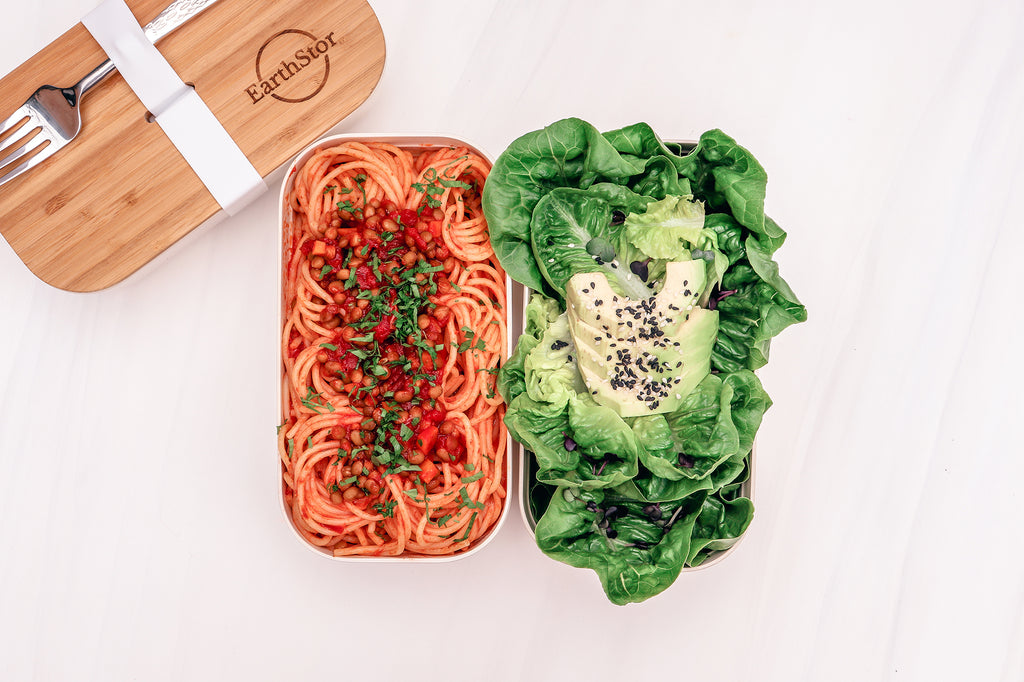 earthstor bamboo bento with spaghetti and salad with avocado