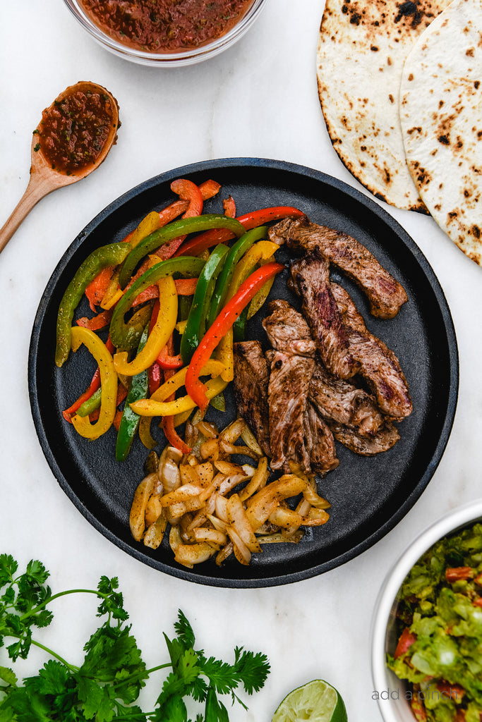 Ribeye Steak Fajitas are so quick, easy and flavorful! Made with perfectly seasoned, tender Ribeye steak, bell peppers and onions, they are always a favorite!