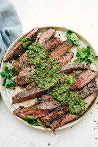 This perfectly grilled flank steak is tender and juicy and topped with the most delicious chimichurri sauce