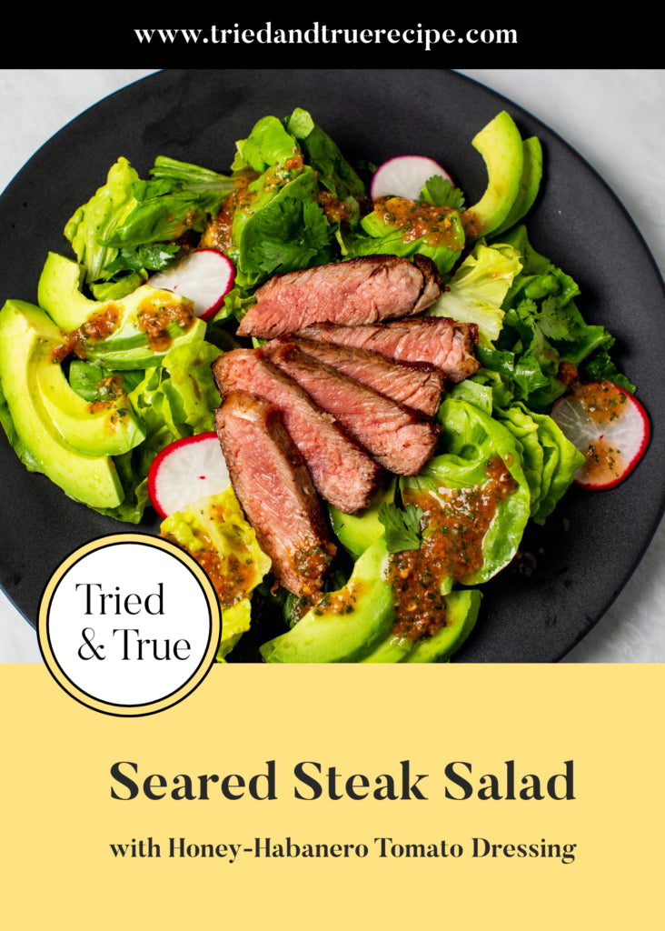This seared steak salad is topped with a sweet and spicy honey-habanero tomato dressing for a an easy, flavor-packed, healthy weeknight meal.