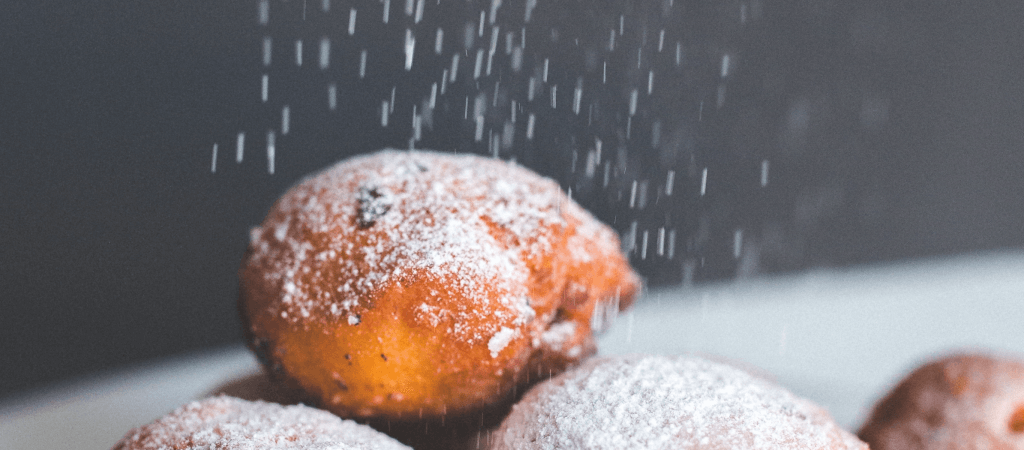powdered sugar and donuts