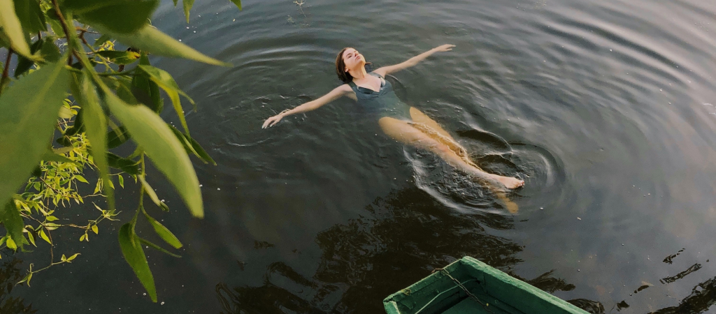 woman floating in lake
