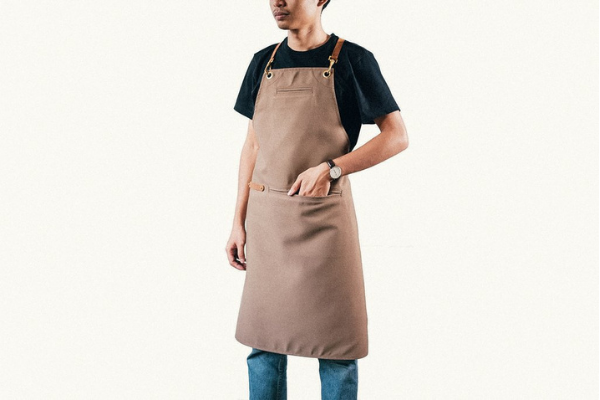 Tan barista apron with man wearing it