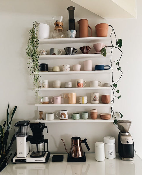 Home coffee bar with shelving for mugs