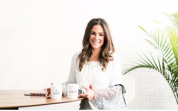 Female owner of City Girl Coffee at her cafe