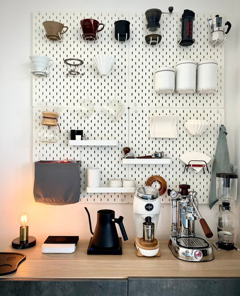 Home coffee bar with pegboard for hanging gear