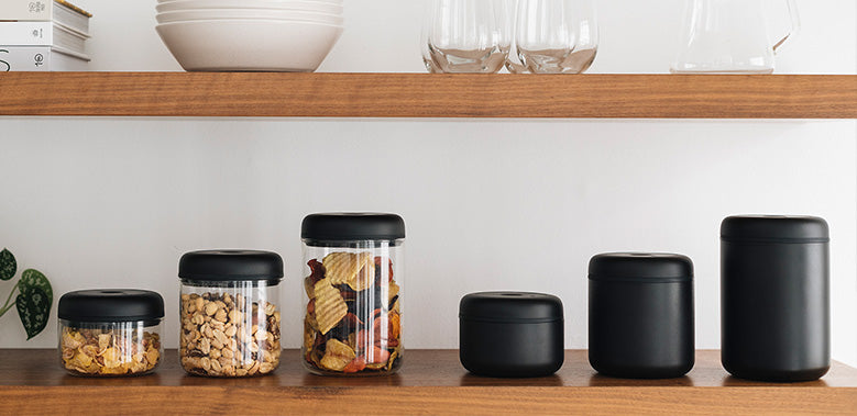 Atmos Vacuum Canisters in All Three Sizes of Glass and Matte Black on Pantry Shelf