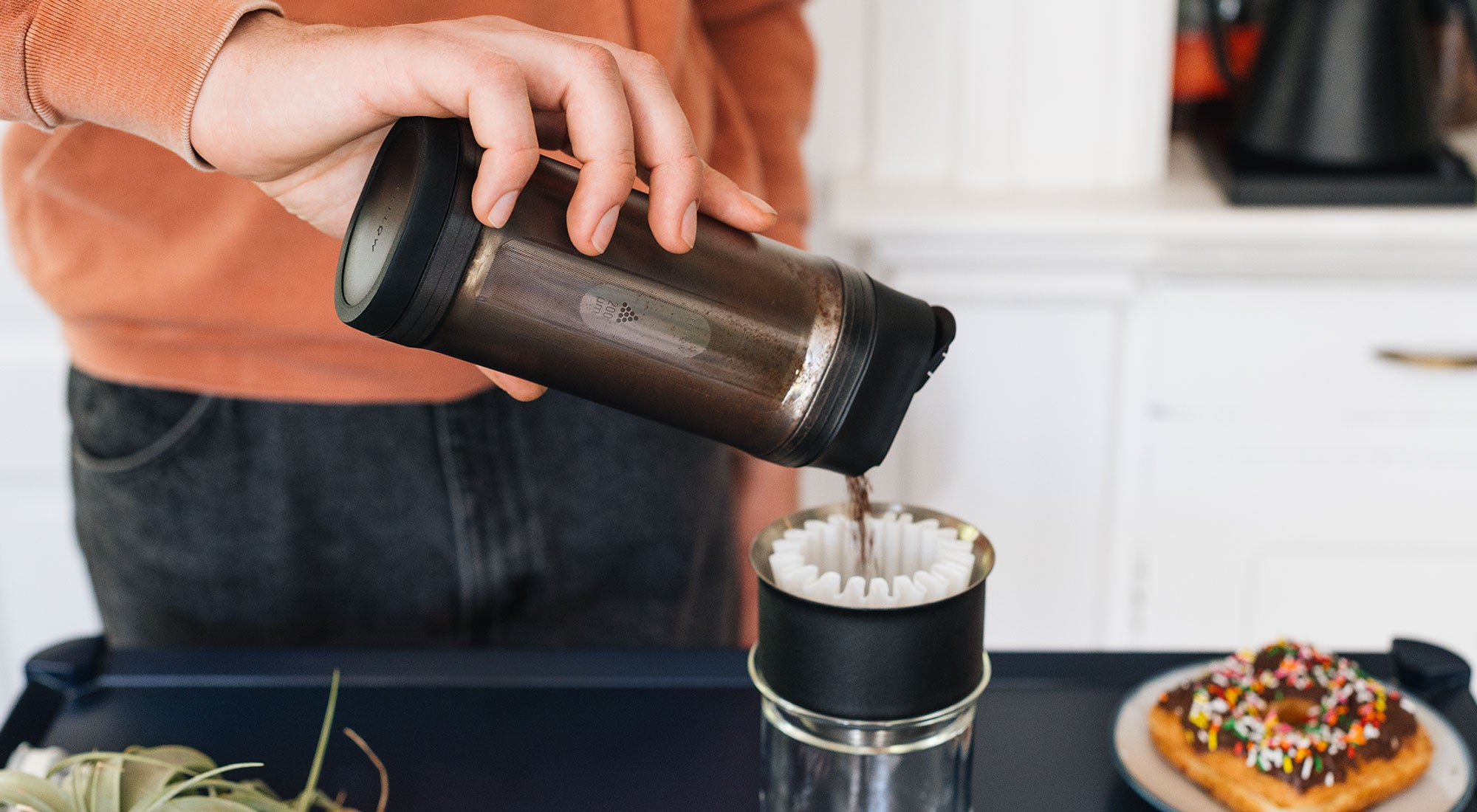 Shimmy Coffee Sieve pouring grinds into Stagg X Pour-Over Dripper