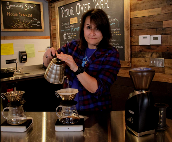 Flight Coffee owner Claudia Barrett making pour-over coffee