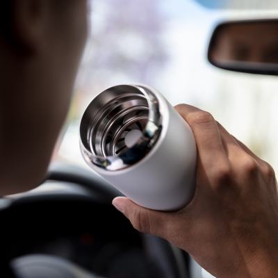 Person driving with Carter Move Mug with Splash Guard in Matte White