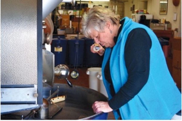 Owner Gayla Moore smelling fresh roasted coffee from Moore Coffee
