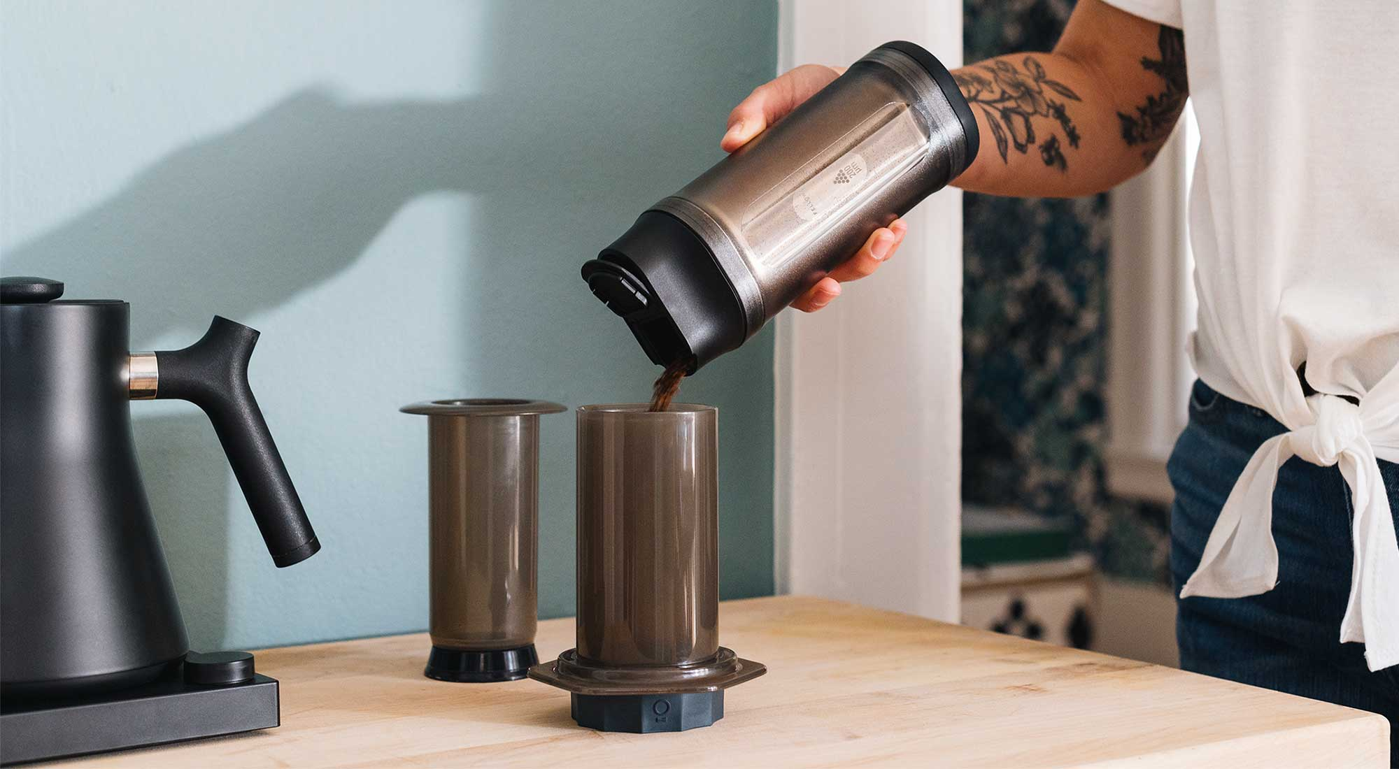 Shimmy Coffee Sieve pouring grinds into Prismo AeroPress Attachment