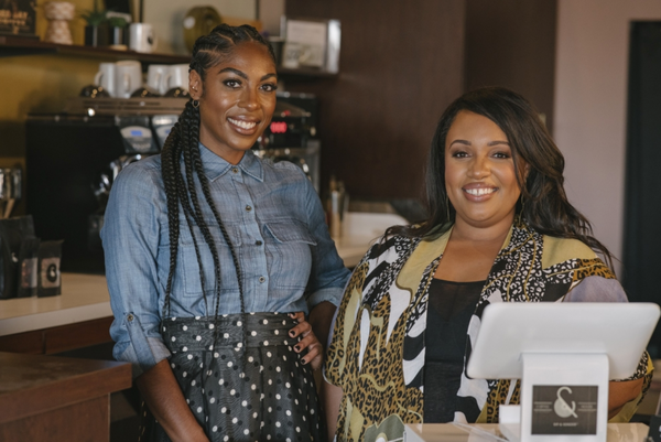 Female owners of Sip & Sonder at their cafe