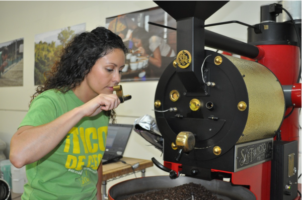 Female owner of Tico Coffee smelling fresh roasted coffee