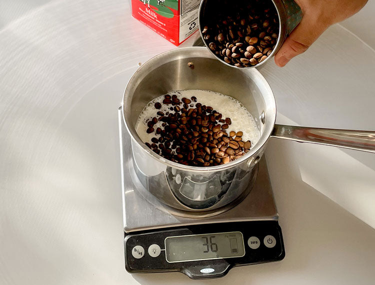Image of Coffee Beans Pouring Into Milk