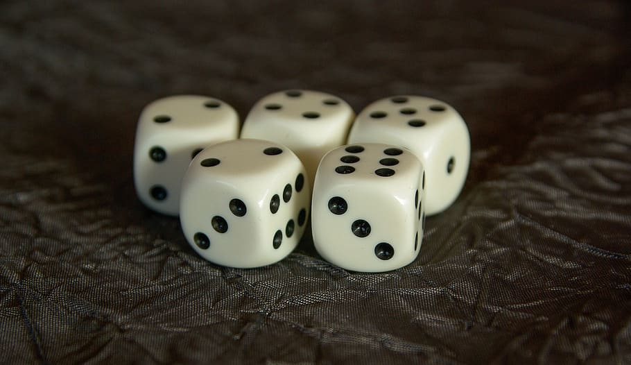 Photo of five 6-sided dice