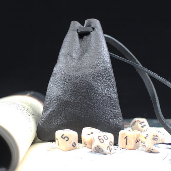 profile shot of leather dice bag