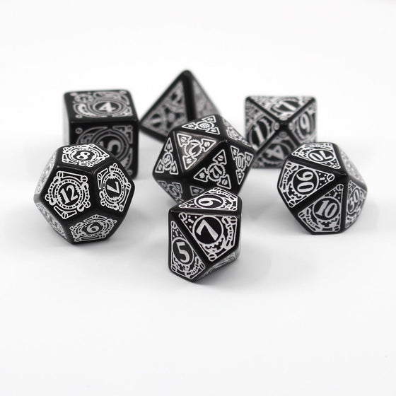 Black Dice with white steampunk designs