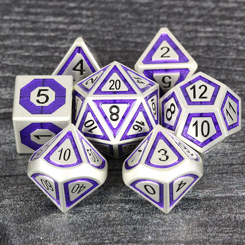 silver and purple metal dice