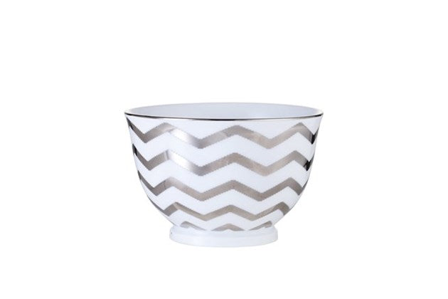 Adrienne Small Serving Bowl white & silver  Exclusive porcelain bowl designed with hand-applied zigzag stripes in silver.  This bowl measures H6.5xØ10 cm and can hold 25 cl. Impress with not just your cooking skills and serve the delicious dish in this Adrienne bowl or incorporate it as a decorative element in your interior design and create a contrast with the classic and well-known.  NOTE: This bowl is dishwasher safe.