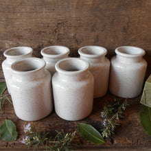 Load image into Gallery viewer, Set of Six White Mustard Jars with Speckled Flecks Glaze. Jeanne d'Arc Living Style Décor. French White Mustard Crocks. Herb Jars. White Jar