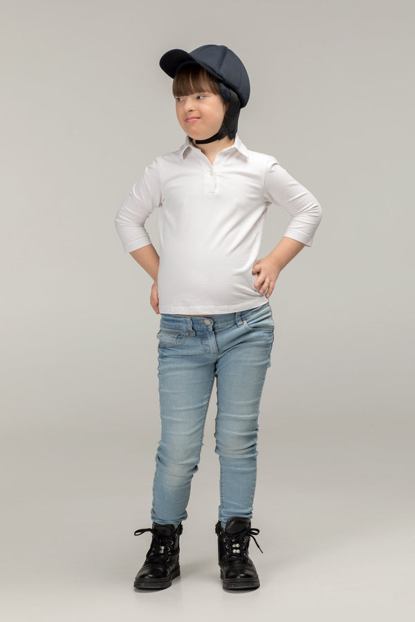 Model wearing extra protective soft helmet for kids by Ribcap