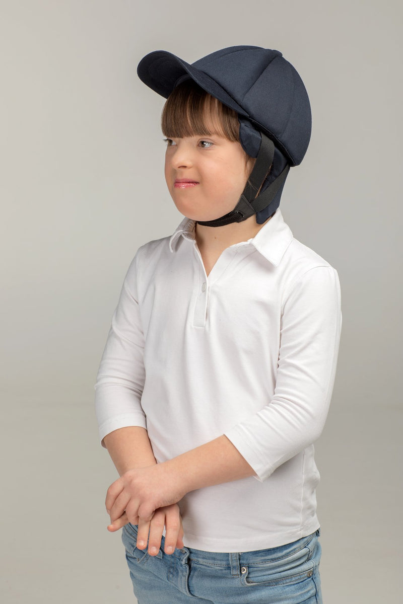 Side view model wearing extra protective soft helmet for kids by Ribcap