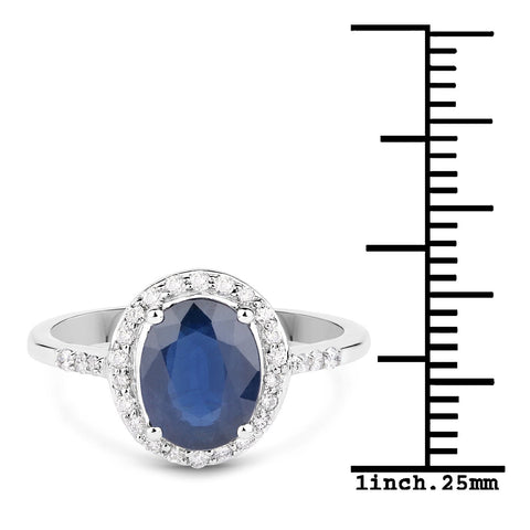 Blue Sapphire and Diamond Halo Cocktail Ring in 14K White Gold