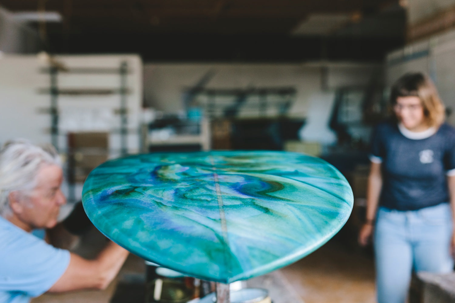 detail image of colour resin design on surfboard