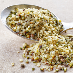 Hemp Seeds on Spoon for Sciatica Pain Relief