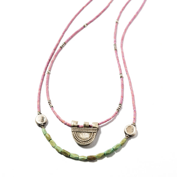 The Abyssinia is a double strand bohemian necklace using soft pink and green stones. This boho necklace uses a Telsum pendant. Like all SASKIA jewelry, this beaded necklace is handmade in our Brooklyn studio using materials from around the world.