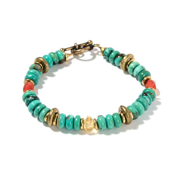 The Alexandria bracelet evokes the timeless charm of the ancient world with it's mix of turquoise, Indonesian glass, citrine and vintage brass. Like all of our handmade jewelry, this boho bracelet is made in our Brooklyn studio using beads and stones from around the world.
