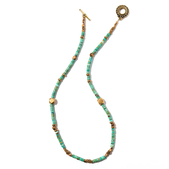 Natural Turquoise and Indian brass in a single strand that is at once subtle and bold. 17""