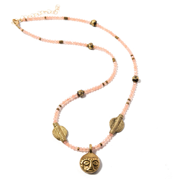 Ashanti is a peach bohemian necklace using African brass accents. This boho necklace uses a soft peach gemstone and brass charm. Like all SASKIA jewelry, this beaded necklace is handmade in our Brooklyn studio using materials from around the world.
