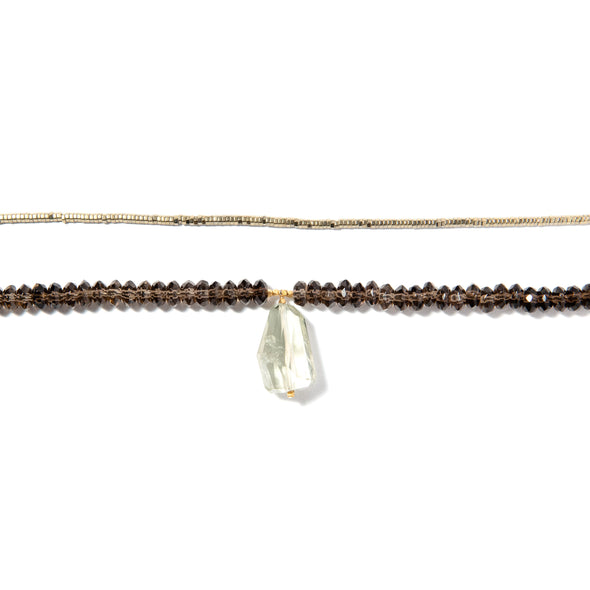 Avalon is a two row necklace using soft green and brown stones. This elegant necklace uses a green amethyst, smoky quartz beads and sparkly hematite. Like all SASKIA jewelry, this beaded necklace is handmade in our Brooklyn studio using materials from around the world.